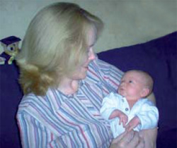 Nurse Patricia Peat and her baby son