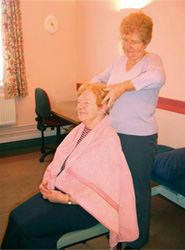 Senior Nurse Hilary Andrews giving a head massage
