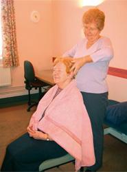 Senior Nurse Hilary Andrews giving a head massage